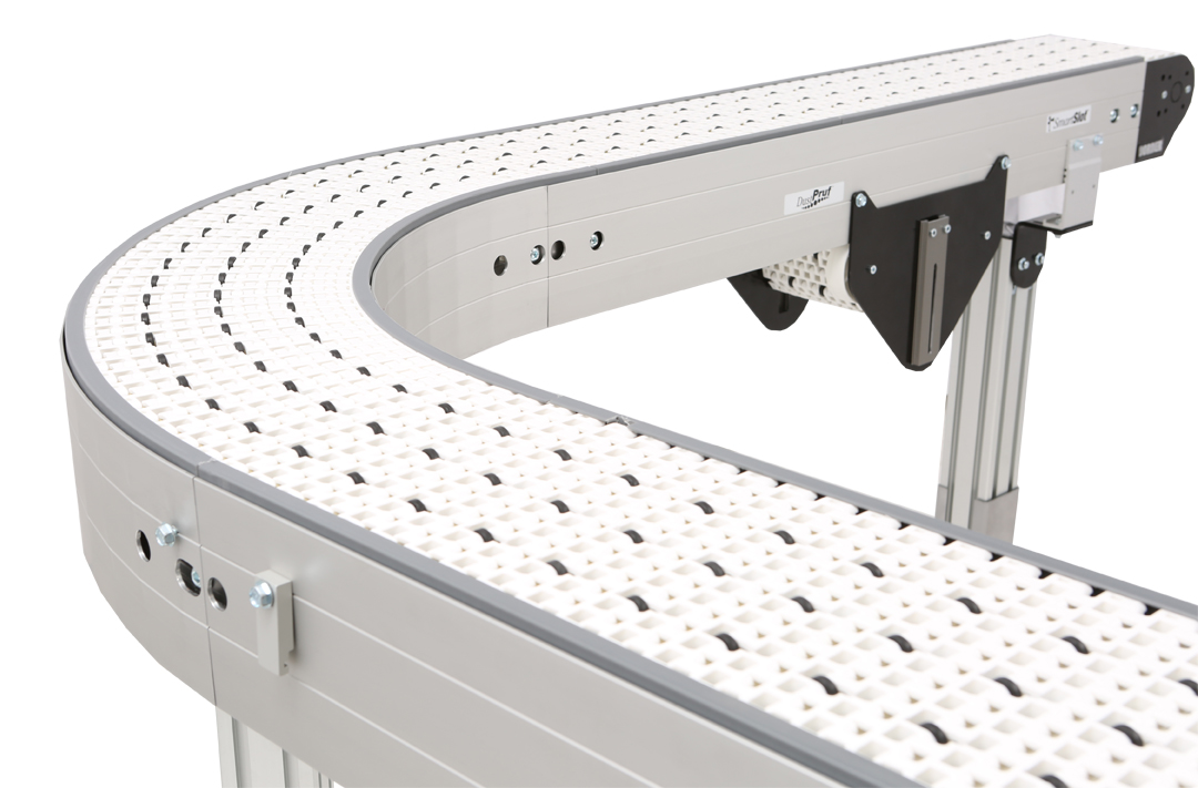 Curved conveyor with roller top belt